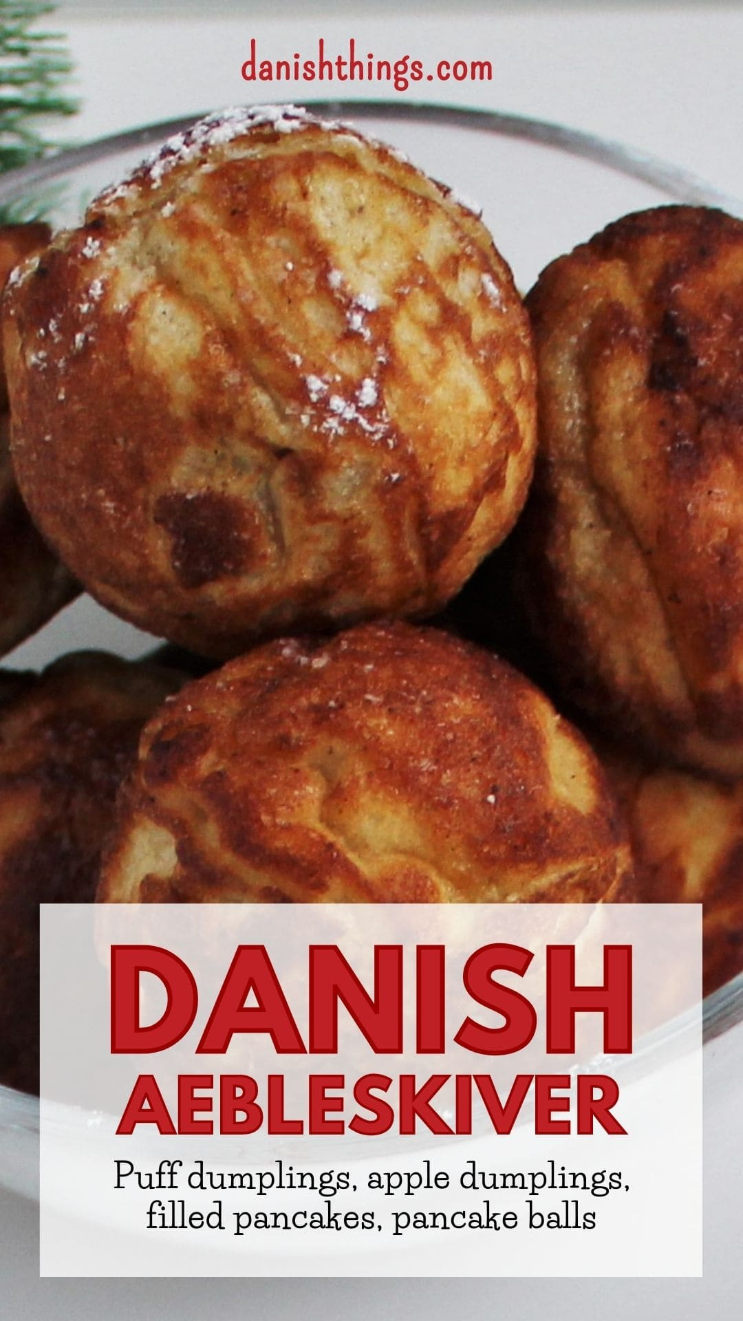 Aebleskiver - Puff dumplings - Apple dumplings - Filled pancakes - Pancake balls – in Danish æbleskiver. The most delicious filled aebleskiver. Danes eat them at Christmastime – you can eat them whenever you like. Fill your aebleskiver with apple compote, jam, marmalade or with extra batter and have nice round aebleskiver. Eat them as they are or serve them with sugar and marmalade. Find the recipe and inspiration for your Danish inspired Christmas @ danishthings.com #DanishThings # Aebleskiver #Puff-dumplings #Apple-dumplings #Filled-pancakes #Pancake-balls #round #pancakes #sweet #dumpling #Danish #æbleskiver #Christmas